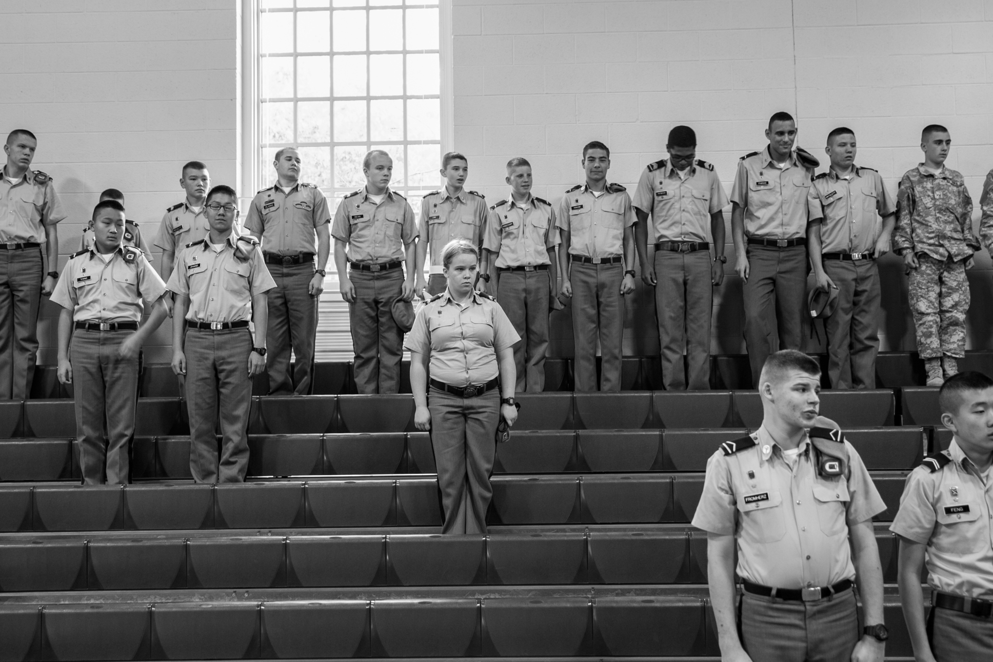 Corporal Emily Hill, a junior, stands among the male cadets during an all-school assembly.