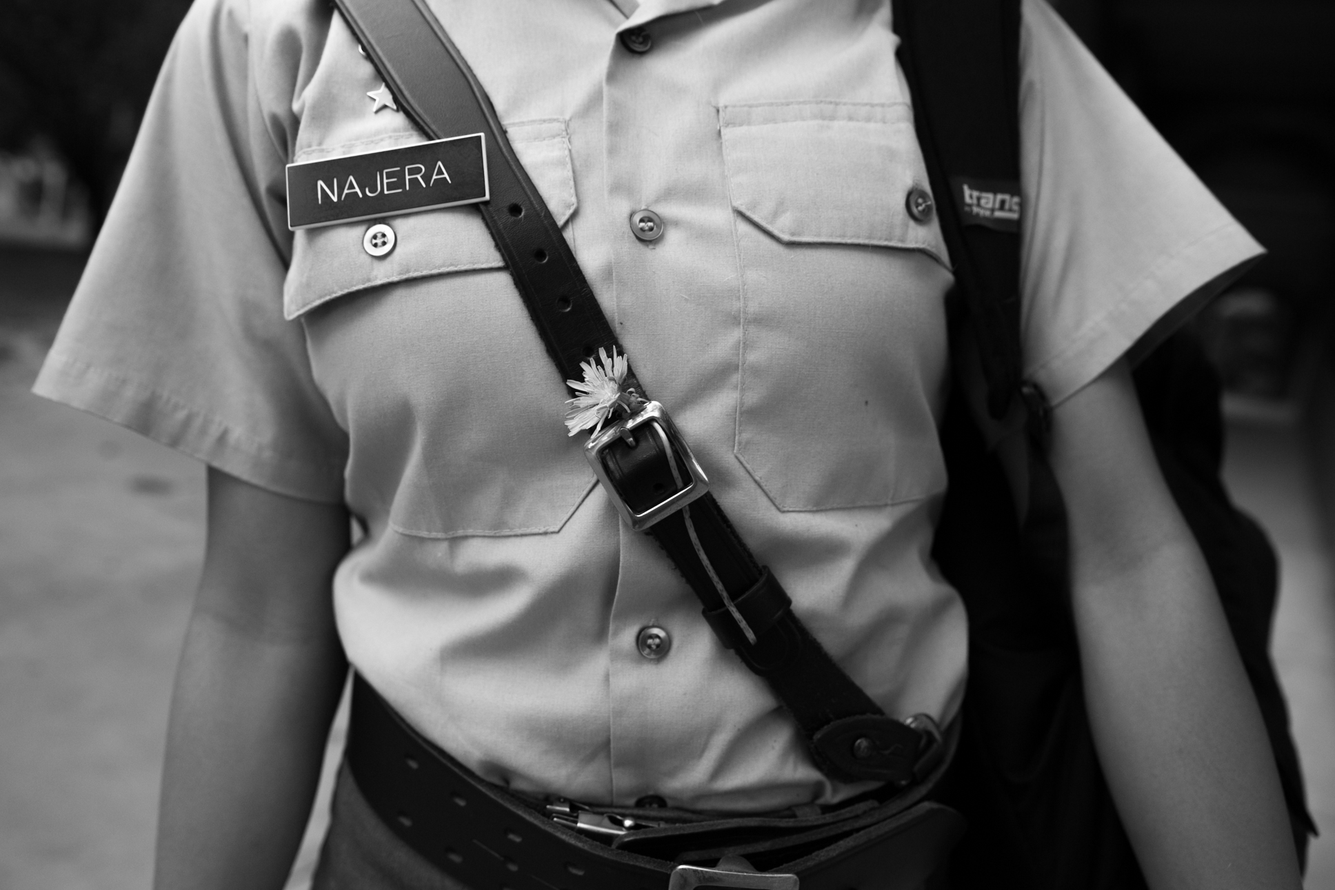 2nd lt. Najera sticks a flower in her uniform. As the female cadets are subject to the same dress regulations as the male cadets, they must express their femininity in other ways.