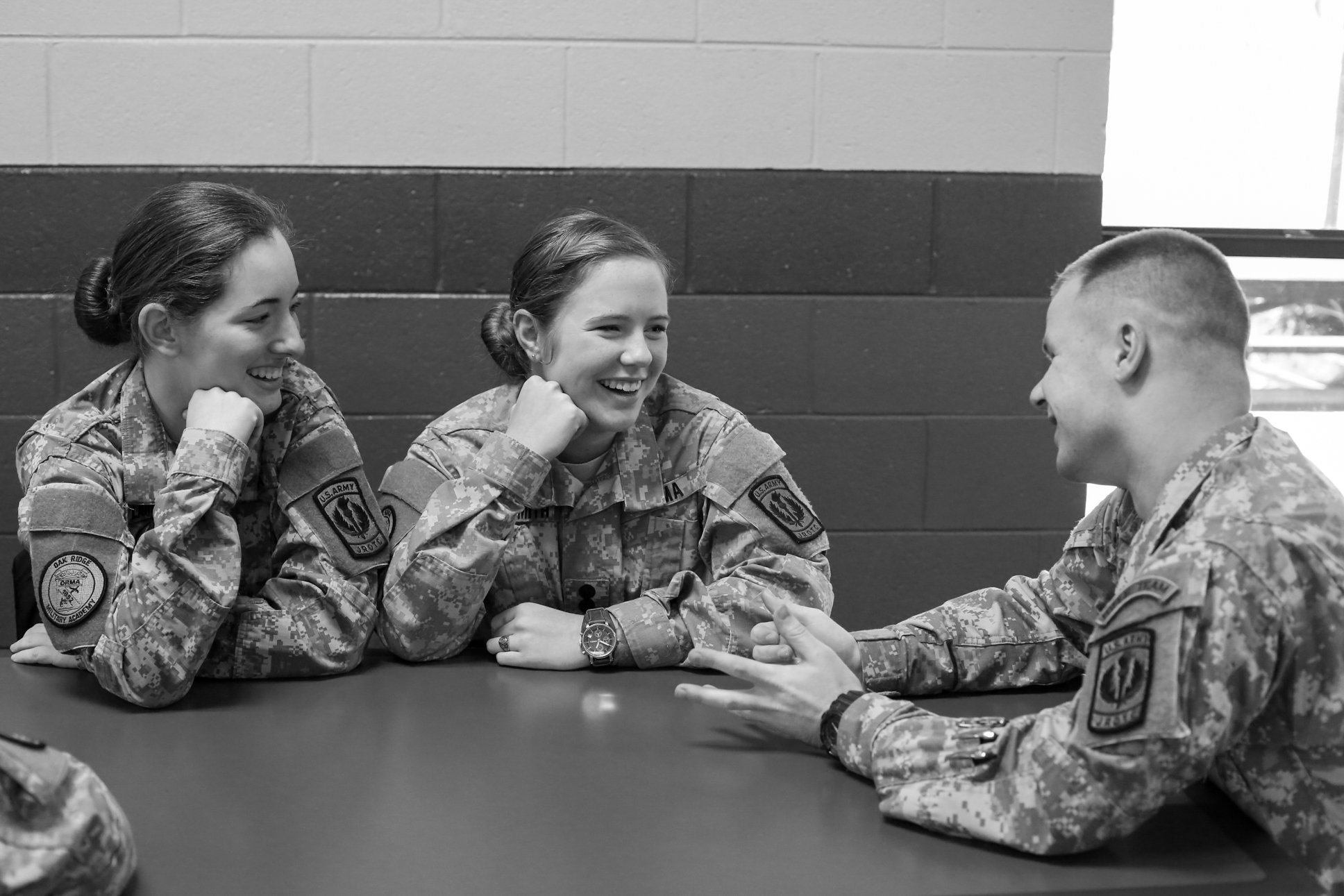 1st Lieutenants and seniors Caitlyn Lambe, Rihanna Davies-Smith and Stephen Davies- Smith, joke around during lunch. Certain privileges are afforded to the senior officers, including lax rules of the strict military school lifestyle.